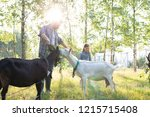 young male farmer with his... | Shutterstock . vector #1215715408