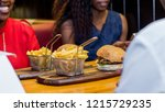 hamburger and fries in a trendy ... | Shutterstock . vector #1215729235
