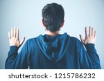 man in back holding hands up | Shutterstock . vector #1215786232