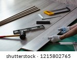 man installs new laminate... | Shutterstock . vector #1215802765