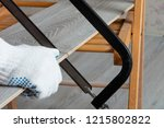 man sawing laminate | Shutterstock . vector #1215802822