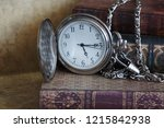 books and pocket watch with... | Shutterstock . vector #1215842938