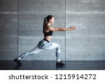 sports girl in the gym doing... | Shutterstock . vector #1215914272