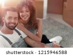 young couple sitting on the... | Shutterstock . vector #1215946588