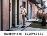 entering house. stylish blonde... | Shutterstock . vector #1215969682