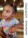 biracial toddler at the arena... | Shutterstock . vector #1215972922