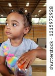 biracial toddler at the arena... | Shutterstock . vector #1215972928