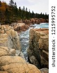 waves crash over rocks on a... | Shutterstock . vector #1215995752