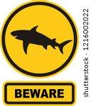 beware sharks sign symbol on... | Shutterstock .eps vector #1216002022