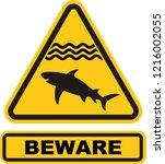 beware sharks sign symbol on... | Shutterstock .eps vector #1216002055