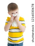 portrait of child boy wiping... | Shutterstock . vector #1216030678