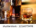 pouring whiskey drink into... | Shutterstock . vector #1216075498