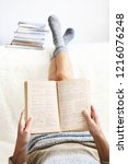 woman is lying feet up on white ... | Shutterstock . vector #1216076248
