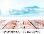 blur tropical beach with bokeh... | Shutterstock . vector #1216103998