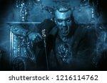 a vampire man is in a dark room....   Shutterstock . vector #1216114762