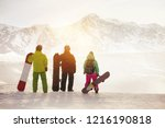 three snowboarders stands with...   Shutterstock . vector #1216190818