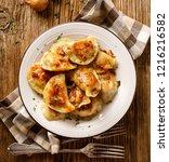 fried dumplings stuffed with...   Shutterstock . vector #1216216582