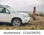 woman standing near suv at the...   Shutterstock . vector #1216234252
