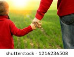 the parent holds the hand of a... | Shutterstock . vector #1216236508
