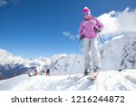 young woman skiing on a snowy... | Shutterstock . vector #1216244872