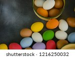 colored eggs on the floor and... | Shutterstock . vector #1216250032
