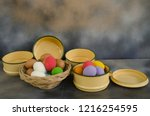 colored eggs in basket and bowl ... | Shutterstock . vector #1216254595