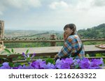happy woman with violet flowers ... | Shutterstock . vector #1216263322