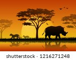 silhouette of rhino at lake in... | Shutterstock . vector #1216271248