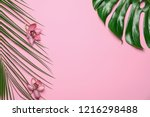 tropical leaves with flowers on ... | Shutterstock . vector #1216298488