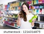 young smiling woman choosing... | Shutterstock . vector #1216316875