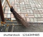an old broom with twigs stands... | Shutterstock . vector #1216349485