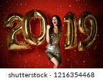 new year. woman with balloons... | Shutterstock . vector #1216354468