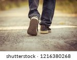one person walking on the road | Shutterstock . vector #1216380268