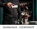 waiter in restaurant sipping... | Shutterstock . vector #1216416625