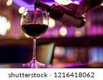 sipping wine in glass | Shutterstock . vector #1216418062