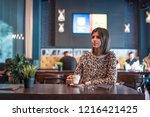 beautiful young female in cafe... | Shutterstock . vector #1216421425