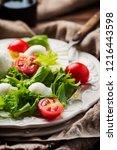 fresh healthy salad witn... | Shutterstock . vector #1216443598