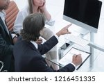 business team discussing a new... | Shutterstock . vector #1216451335