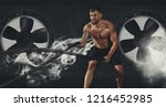 men working out with battle... | Shutterstock . vector #1216452985