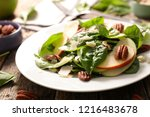 spinach salad with apple and...   Shutterstock . vector #1216483678