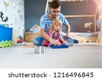 father playing with daughter at ... | Shutterstock . vector #1216496845