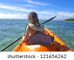 young girl kayaking on... | Shutterstock . vector #121656262
