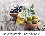 olives with olive oil on wooden ... | Shutterstock . vector #1216586992