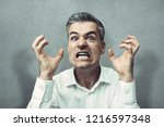 angry furious man screaming at... | Shutterstock . vector #1216597348