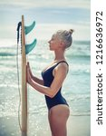 beautiful girl surfer with a... | Shutterstock . vector #1216636972