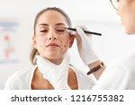 plastic surgeon making marks on ... | Shutterstock . vector #1216755382