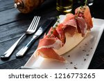 parma ham with melon on a white ... | Shutterstock . vector #1216773265