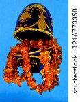 amber beads in a box easter egg ... | Shutterstock . vector #1216773358