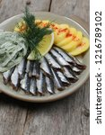 sprat dishes with potatoes | Shutterstock . vector #1216789102