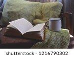 vintage mug and old book on... | Shutterstock . vector #1216790302